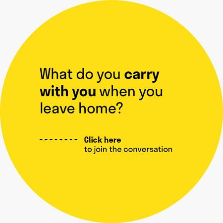 "A yellow circle with the question ""What do you carry with you when you leave home?"""