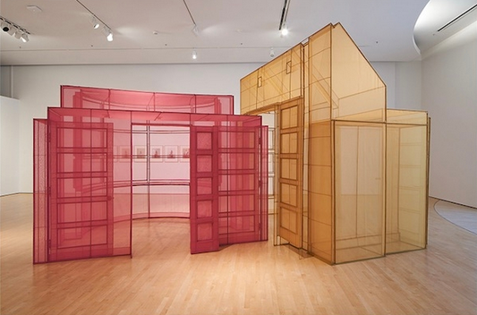 An image depicting Do Ho Suh's artwork, a pink and a yellow house